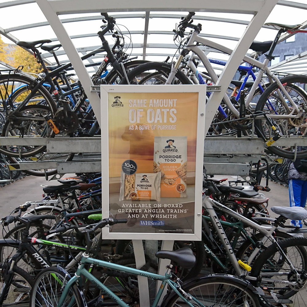 Quaker poster on station cycle racks