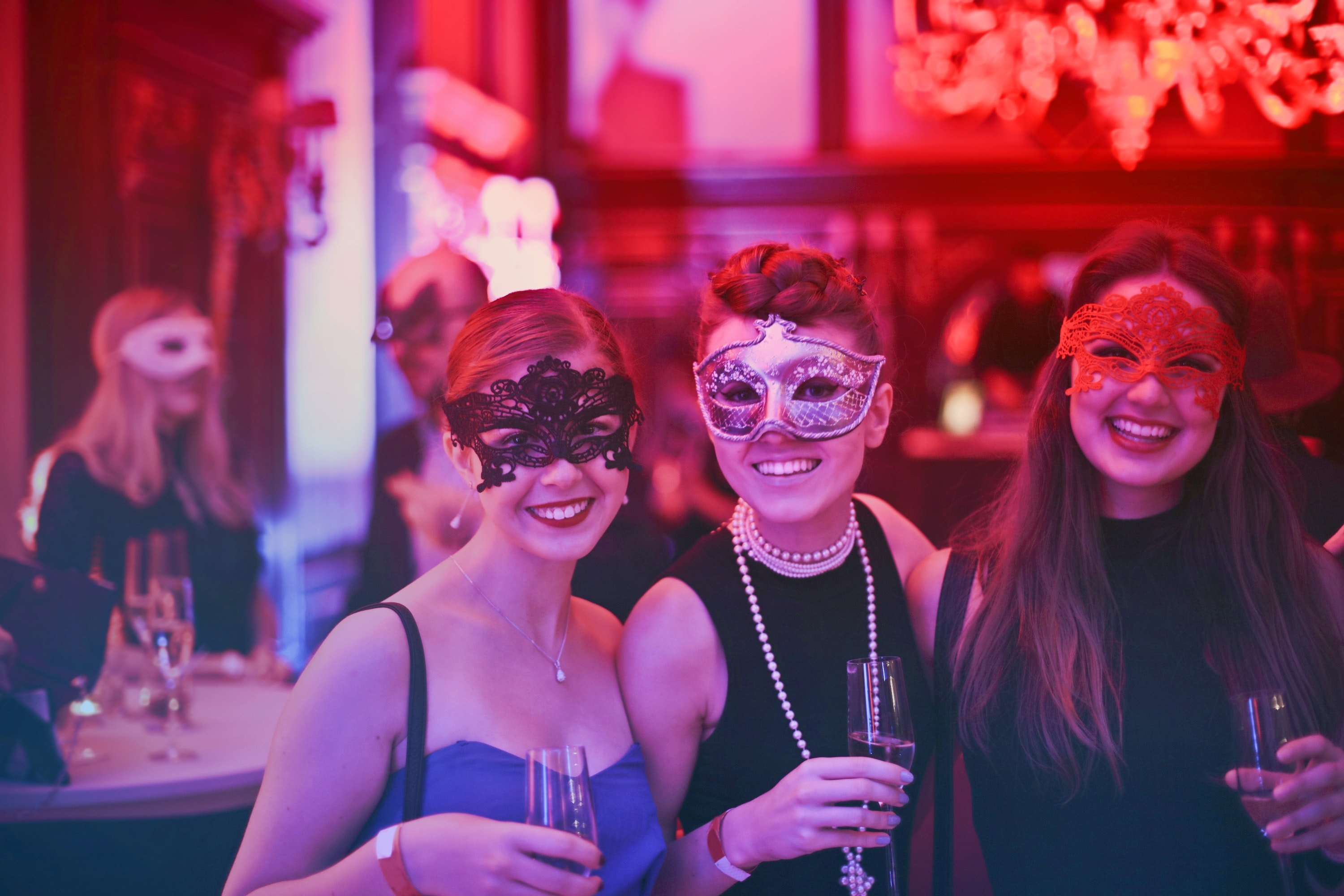 Group of women at masked ball