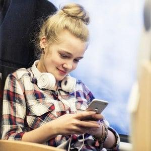 About Abellio woman with headphones on train
