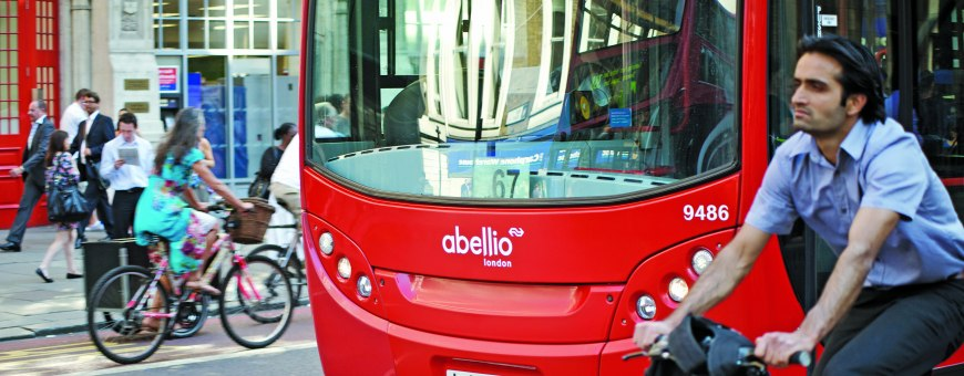 Red Abellio bus with cyclist in front