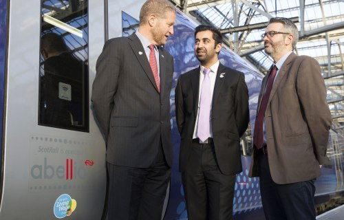 ScotRail - Phil Verster and Mr Humza Yousaf MSP in front of train with living wage logo